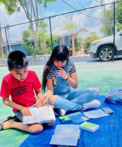 Boy and girl reading and learning about the Bible in Sarasota.